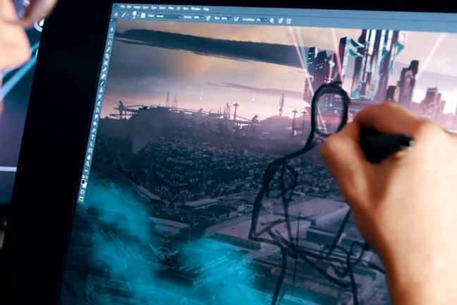 A developer's hand draws the outline of a character on a computer screen