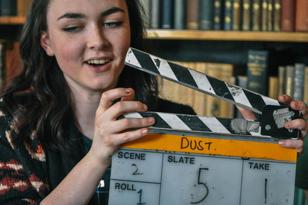 Girl with clapperboard