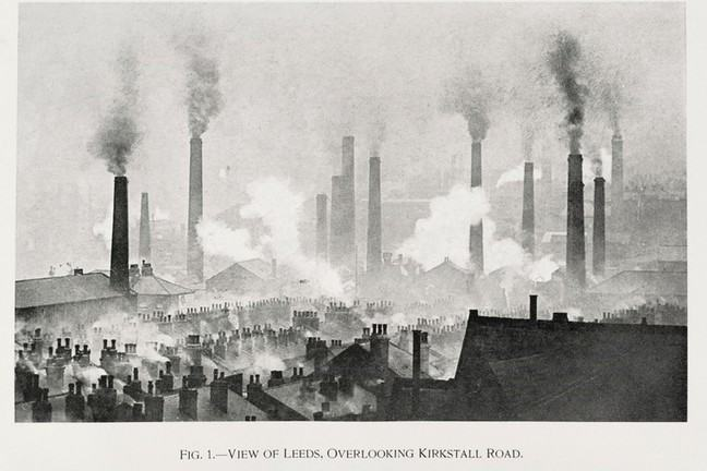 An old black and white painting of Leeds cityscape and rooftops with large industrial chimneys emitting smoke and domestic chimneys also emitting smoke