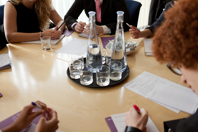 Group of people meeting around a table
