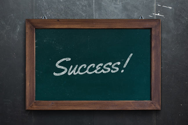 Success written on a green chalkboard