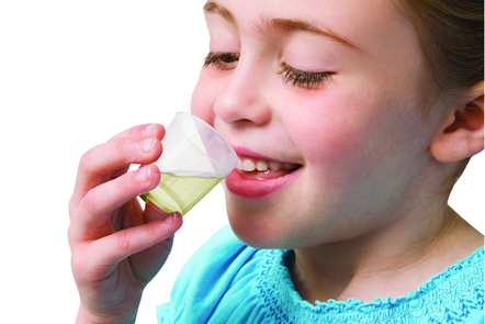Child drinking cup of medicine