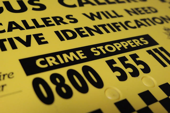 A close up of a Crimestoppers sign