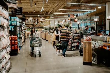 Consumers shopping in a supermarket