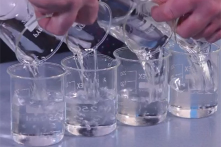 Pouring into four beakers
