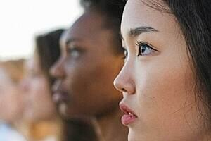 Profiles of women of various ethnicities  looking forward
