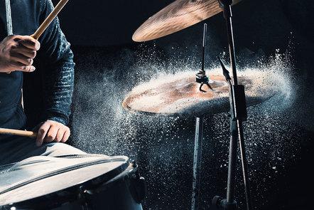A drummer hitting a high-hat cymbal