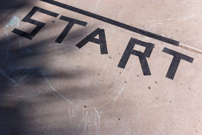 "The word ""START"" created from black tape onto flooring"