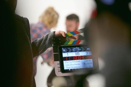 A clapper board in front of a scene about to be filmed