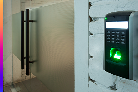 Photographic image of a digital identity scanner at a locked door