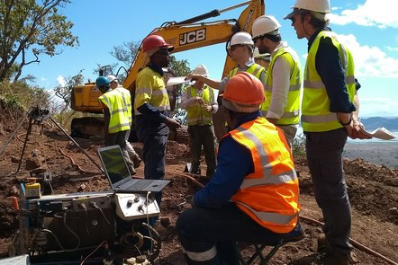 Drilling workers wearing health and safety protective clothing