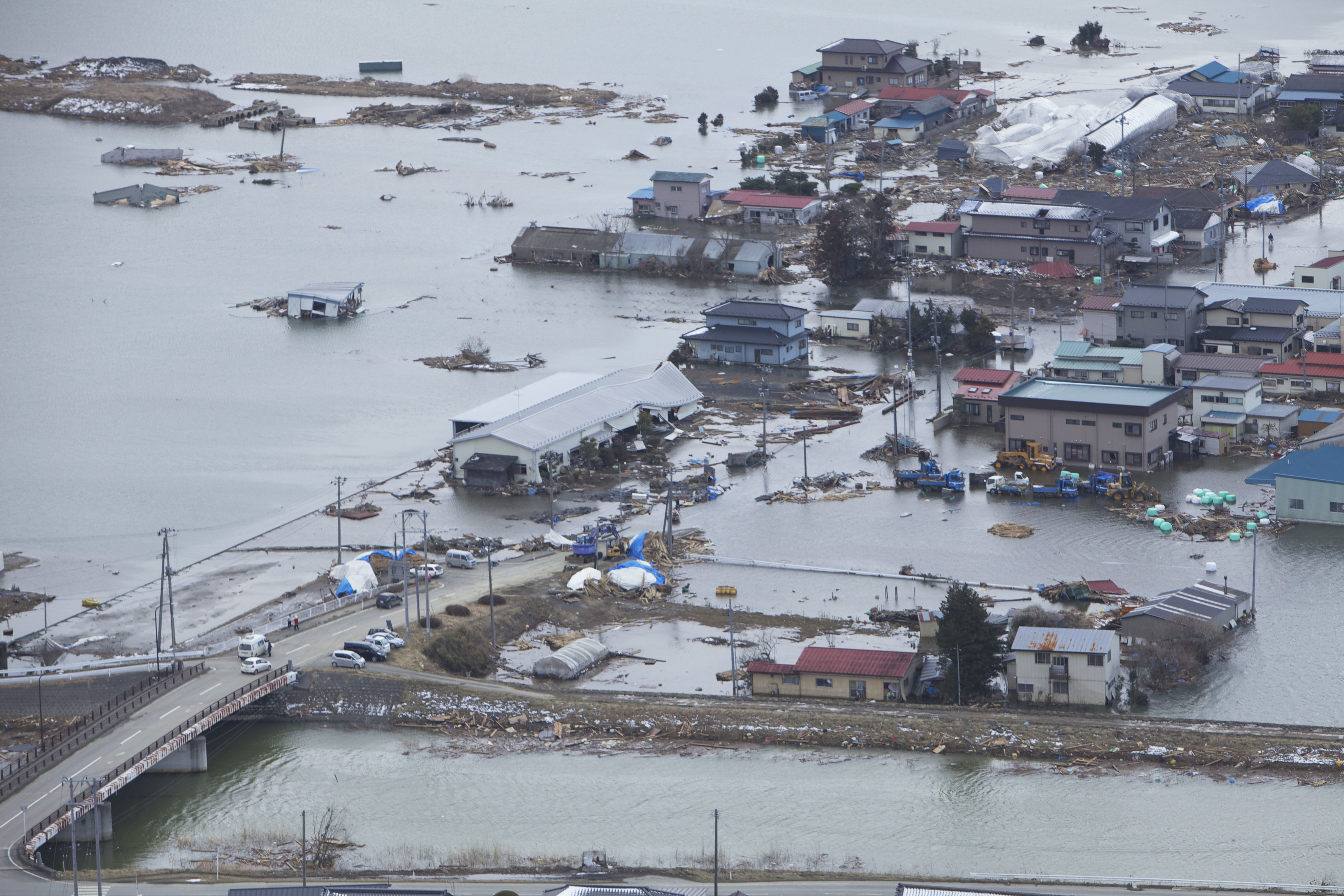 An aerial view of Ishinomaki, Japan, a week after a 9.0 magnitude earthquake and subsequent tsunami devastated the area. Showing flooding, damaged buildings and roads.