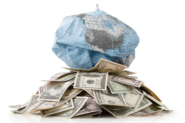 Unsustainable development. Heap of money with globe deflates