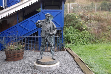 Statue of a Victorian railway navvy at Gerrards Cross station