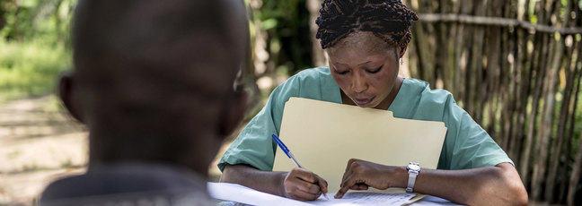 Nurse writing notes