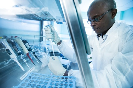 Lab techician, George Giathi Kamau, preparing samples in a laboratory in Kenya