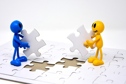 two people putting puzzle together