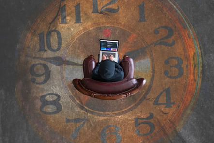 Man in chair surrounded by clock