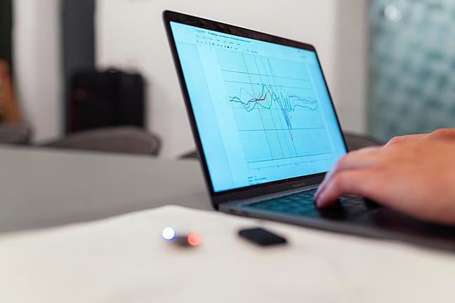 Person on laptop looks at graph