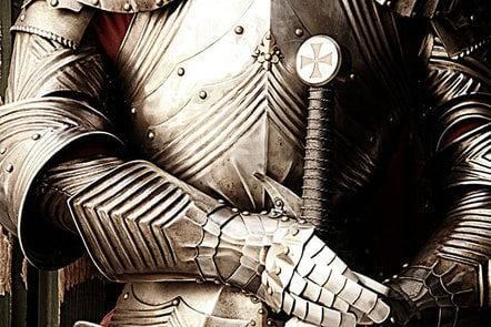A suit of armour with the hilt of a sword.