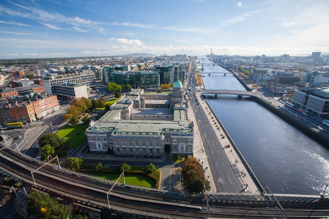 An aerial view of Dublin, Ireland. A large river runs through a busy city.