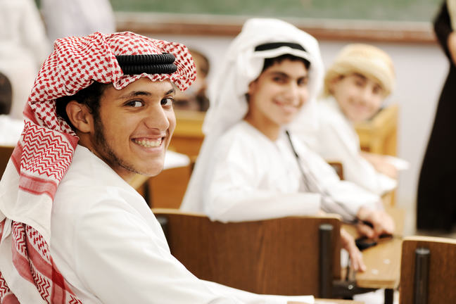 Students in classroom in traditional arabic dress