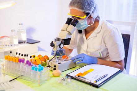 Scientist in lab testing food.