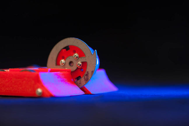 Small robot created by a student at the University of Reading, with spinning wheel and 2 small flippers