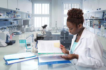 African scientist, medical worker or tech in modern laboratory.
