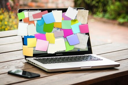 A laptop covered in post-it notes