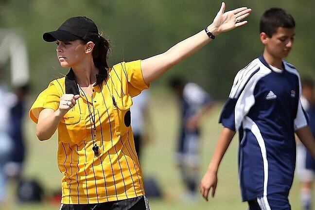 A soccer referee making a ruling