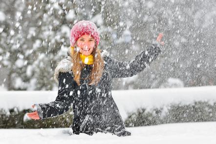 Snow falling down on girl