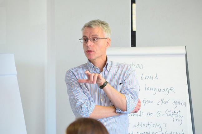 Robert Jones standing in front of a whiteboard