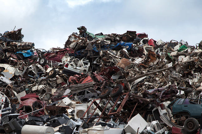 Photo of a large pile of scrap metal - mainly cars.