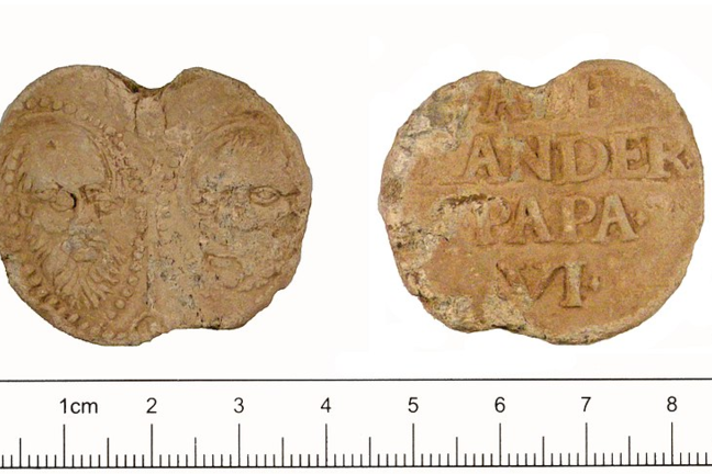 A cast of lead Papal Bulla of Pope Alexander VI showing two heads on one side and the words Alexander Papa VI on the other side.