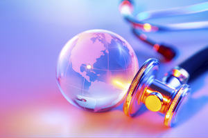A crystal ball with image of the Earth superimposed on it with a stethescope next to it