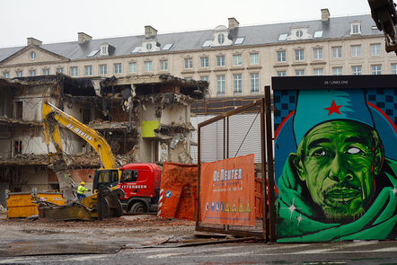 A construction site, Brussels train station in the background, and a graffiti in the foreground