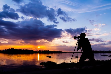 Photographer taking a picture of a sunset