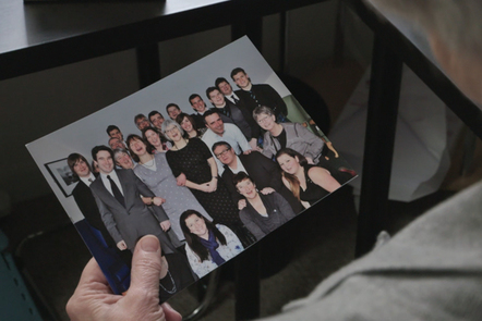 Woman looking at a family photo