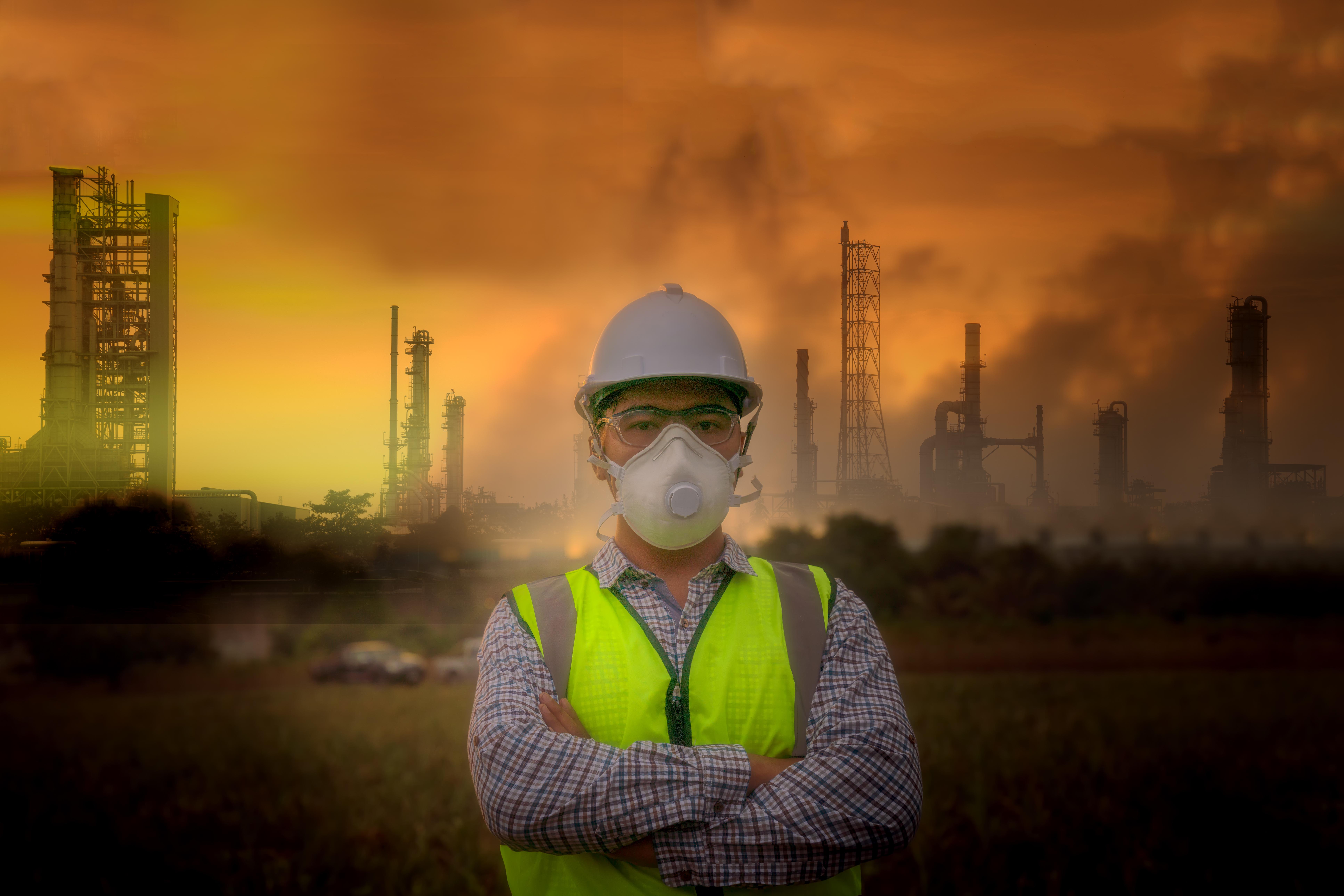 Environmental officials put air pollution masks ,environmental problems, pollution industry concept