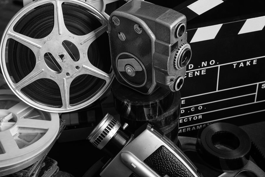 Old style film cameras with film reels and clapperboard
