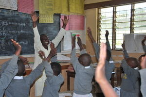 A teacher in an African classroom using active learning with his children