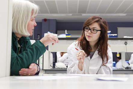 A mentor providing feedback to a hospital professional