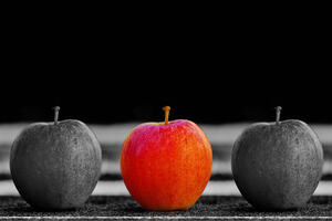 two black and one red apples