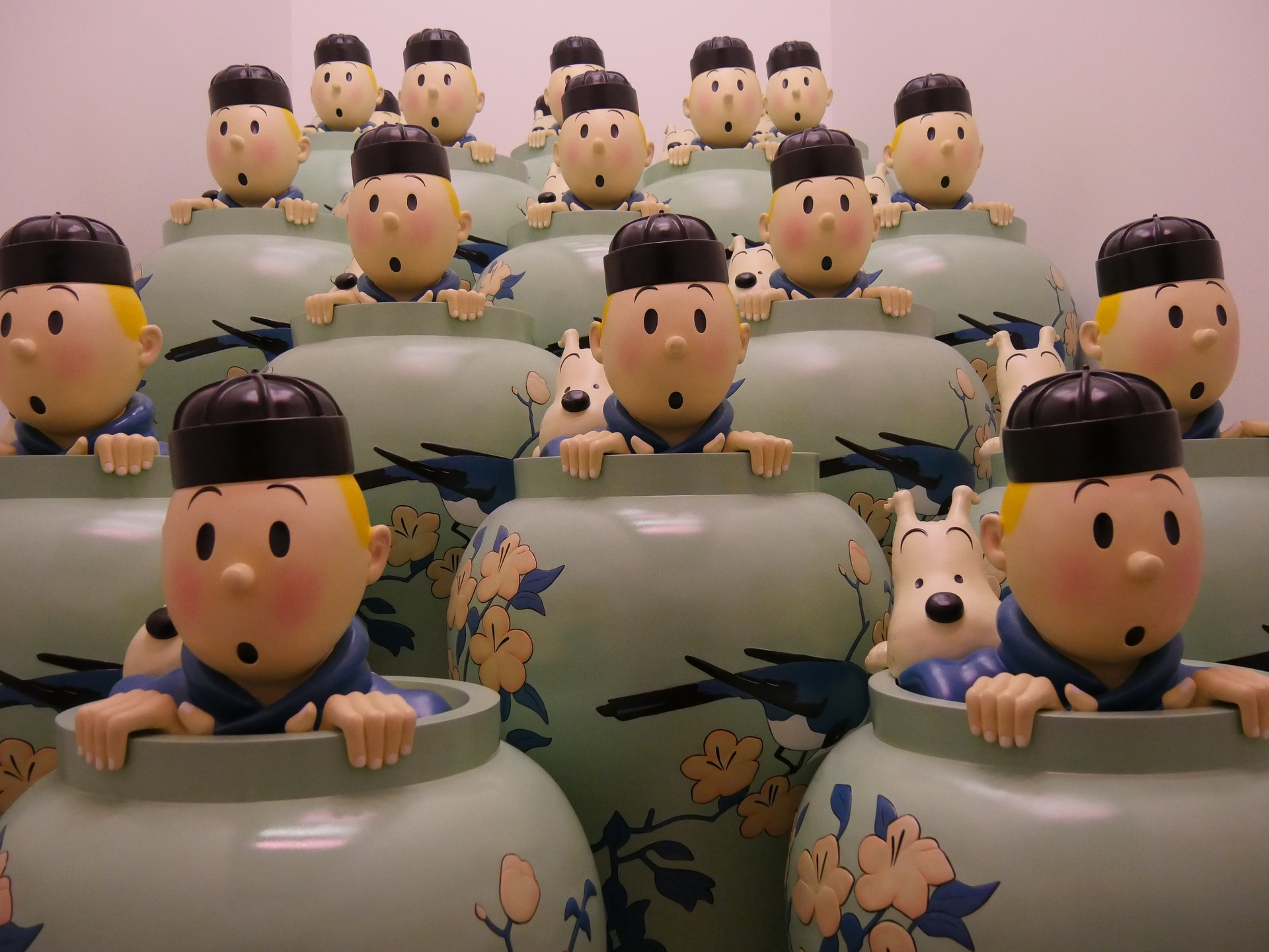 Cartoon figures of boy and dog peeping out of vases
