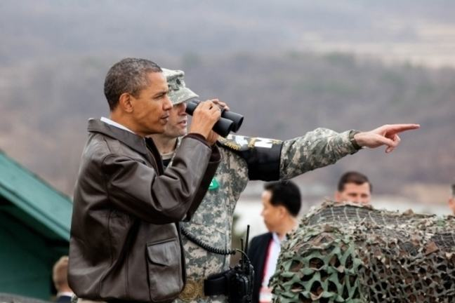 President Barack Obama is briefed by Lt. Col. Ed Taylor as he views the DMZ from Observation Post Ouellette at Camp Bonifas, Republic of Korea, March 25, 2012.