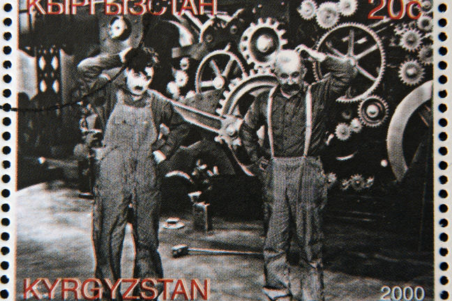 "A stamp from Kyrgyzstan shows scene from the movie ""Modern Times"" by Charles Chaplin, circa 2000"
