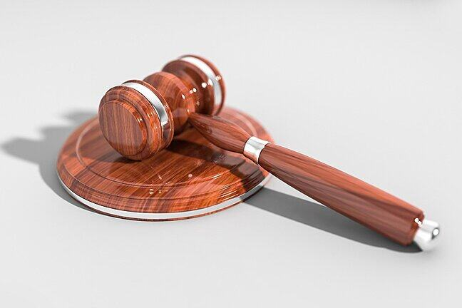 Judges hammer sitting on a white background
