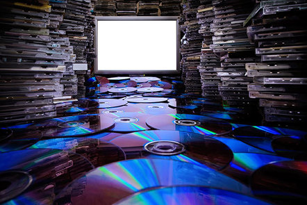 Hundreds of CDs and CD cases, illuminated by a white screen.