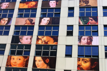 Prints of Renaissance paintings on an office building